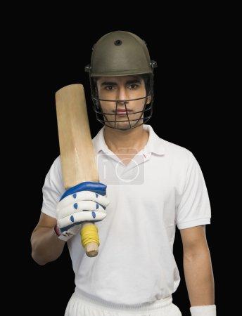 Cricket batsman holding a cricket bat
