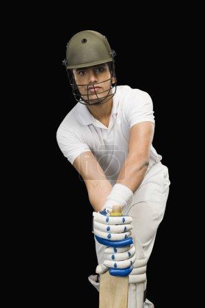 Cricket batsman in forward defensive stance