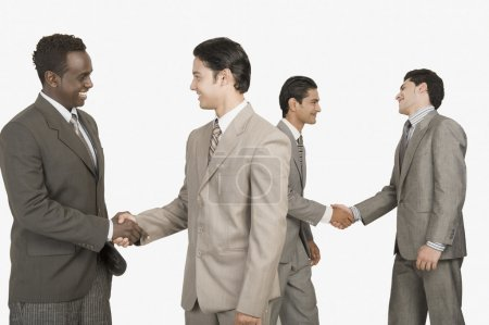 Photo for Four businessmen shaking hands - Royalty Free Image
