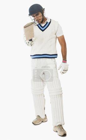 Cricket batsman showing his bat