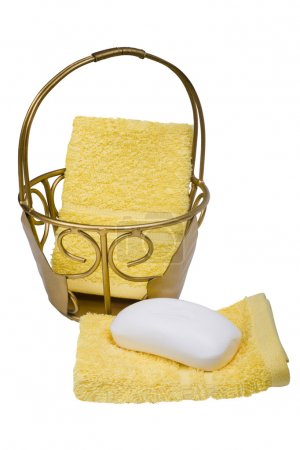 Bar of soap with towels and a basket
