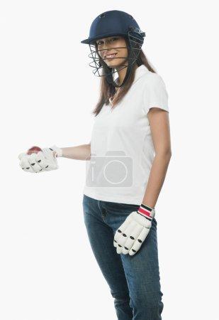 Female cricket fan smiling