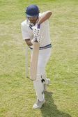 Batsman in backward defense stance