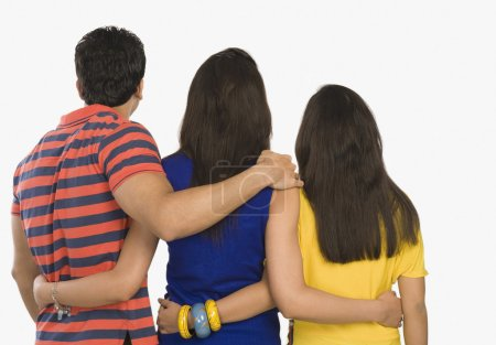 Photo for Rear view of three friends standing on white background - Royalty Free Image