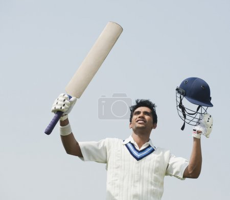 Cricket batsman celebrating
