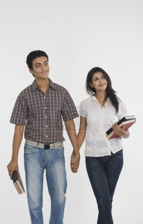 College students walking with holding hands
