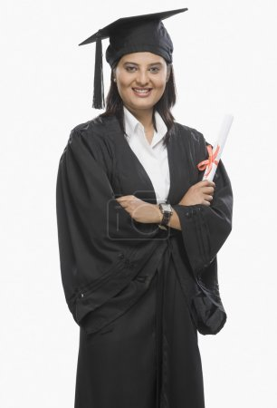 Photo for Woman holding a diploma in graduation gown - Royalty Free Image
