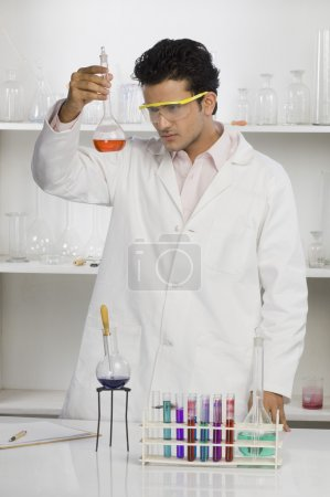 Scientist examining a flask in a laboratory