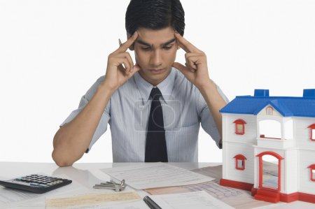 Real estate with head in hands