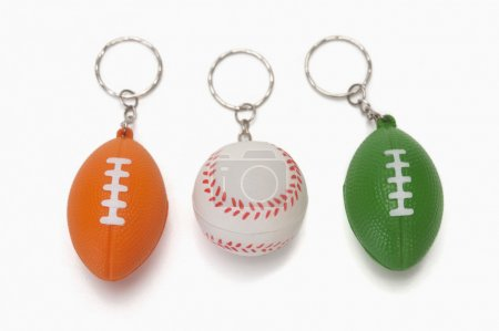 Assorted key rings of balls representing Indian flag colors