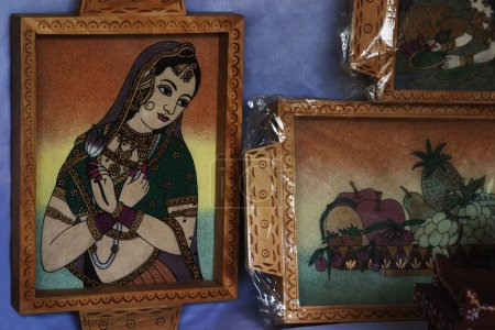 Paintings at a market stall