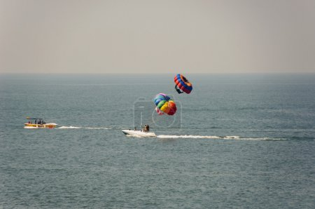 Tourists parasailing in the sea
