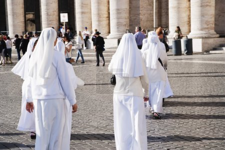 Nuns walking at a square