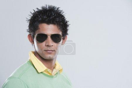 Portrait of a man wearing dark glasses...