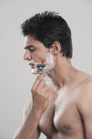 Photo for Man with shaving cut on gray background - Royalty Free Image