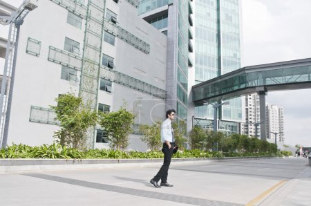 Businessman standing in front of an office building