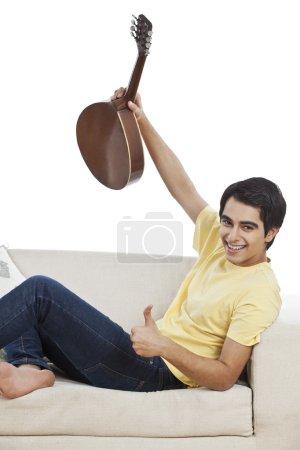 Man holding a mandolin