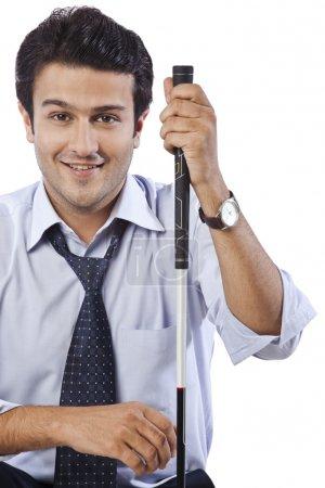 businessman holding a golf club