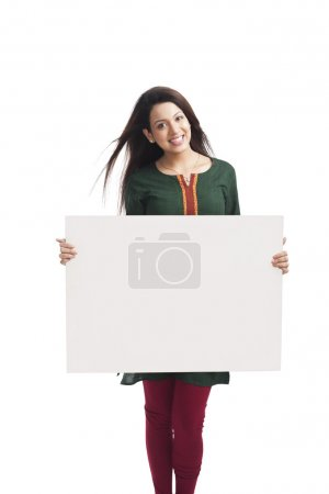 Woman holding a whiteboard