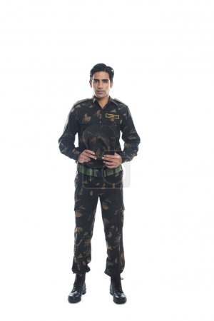 Photo for Portrait of an army soldier holding a cap - Royalty Free Image