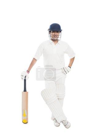 Batsman standing with a cricket bat