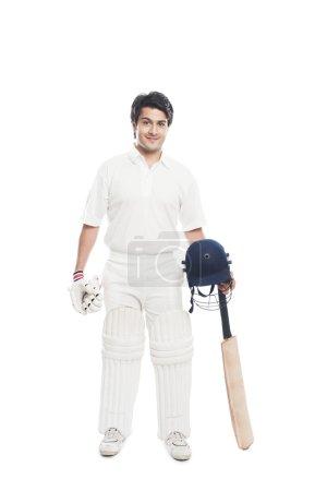 Batsman holding a cricket bat