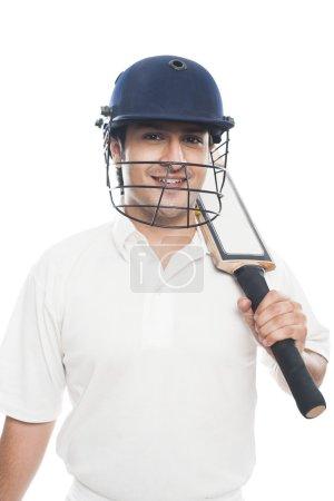 Batsman with holding a cricket bat