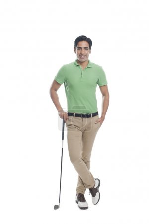 Male golfer standing with a golf club