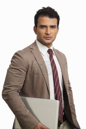 Businessman holding a laptop