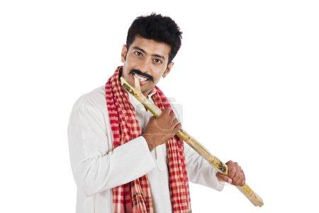 Portrait of a man eating sugar cane
