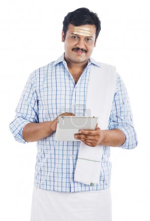South Indian man using a digital tablet