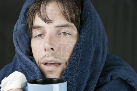 Sick Man Holding Mug