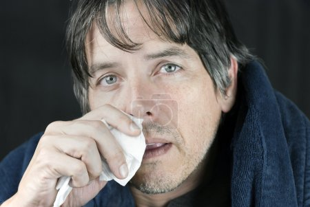 Sick Man In Housecoat With Tissue