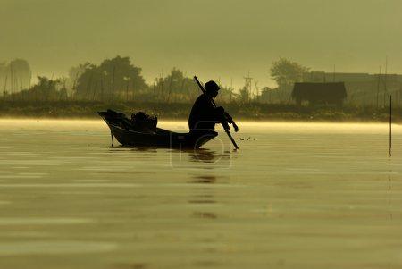 Fisherman of Inle Lake waiting fish
