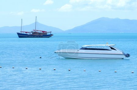 yacht speed boat and traditional boat on the sea with mountain b