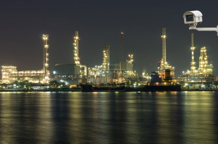 Security camera monitoring the Oil and gas refinery at night tim