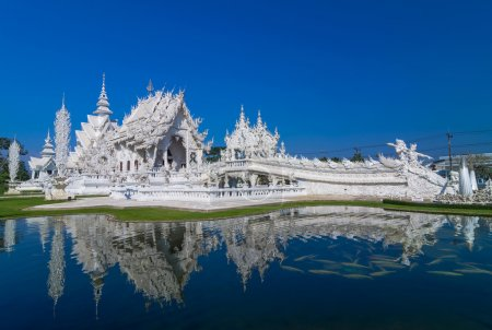 Photo for Beautiful white church and reflection with the water, Rong Khun temple, Chiang Rai province, northern Thailand - Royalty Free Image