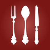 Fork Knife and Spoon on red dark background