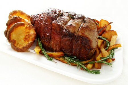Roast beef joint with seasonal vegetables