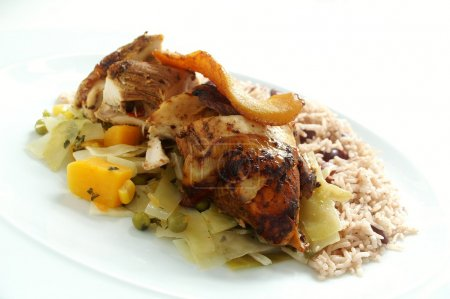 Jerk chicken with rice peas and steamed cabbage