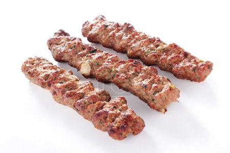 Indian Shish Kofte Kofta kebabs isolated on white background
