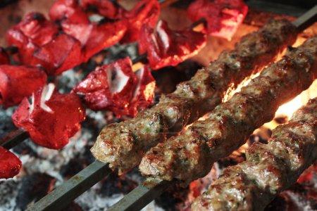Indian chicken tikka and kofte kofta shish kebabs on barbecue