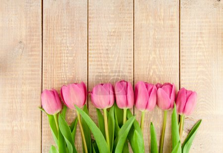 Photo for Bouquet of pink tulips on a wooden background - Royalty Free Image