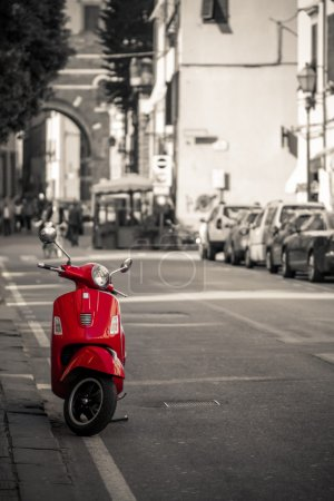 Retro red scooter in Italy street