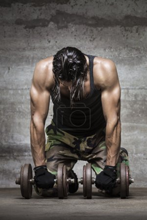 Photo for Tired muscle athlete - Royalty Free Image