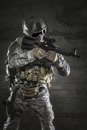 Photo for Soldier with mask aiming a rifle - Royalty Free Image