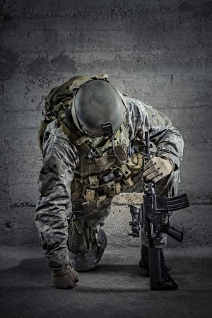 Photo for Soldier with rifle and helmet - Royalty Free Image