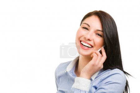 smiling young brunette woman talking on the phone