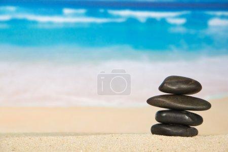 Pebbles on the sandy coast against the sea