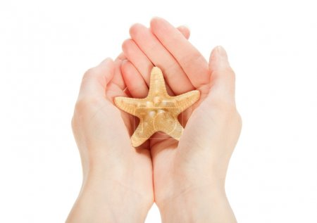 Starfish in the hands, isolated on white